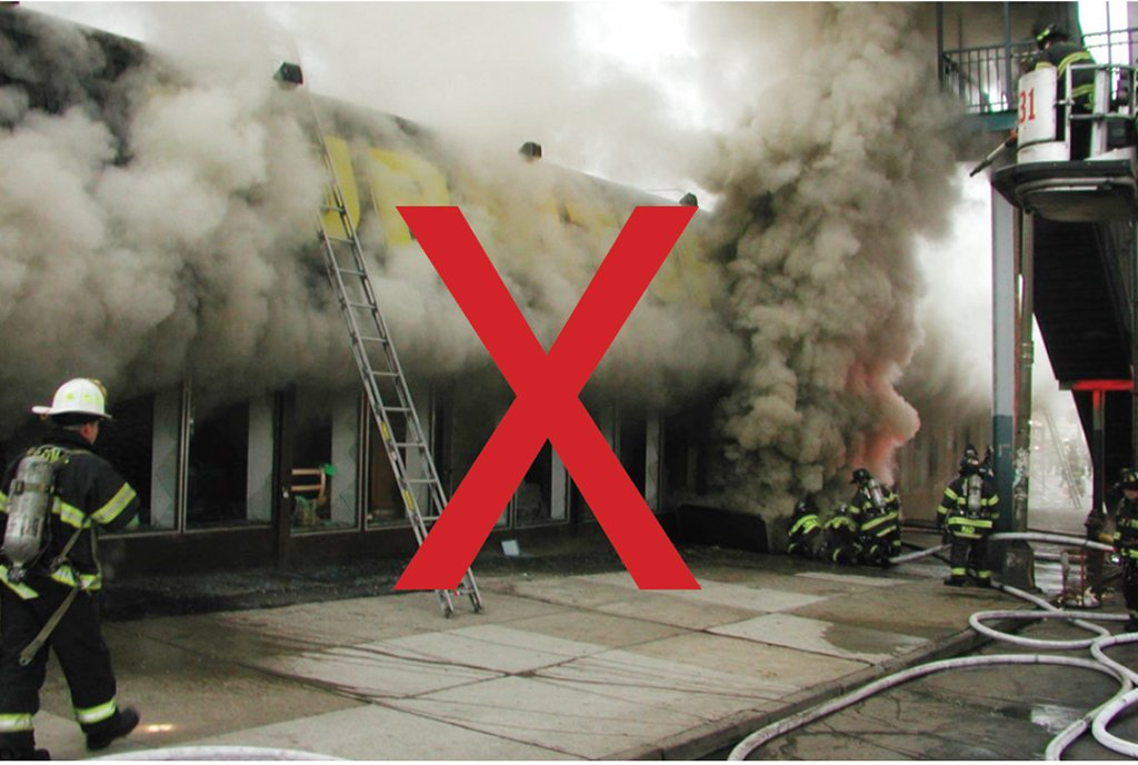 If fire vents from the show window, the member on the portable ladder could be exposed to heat and/or flame.